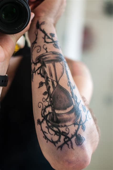 unique arm tattoos cool sandclock arm best ideas designs