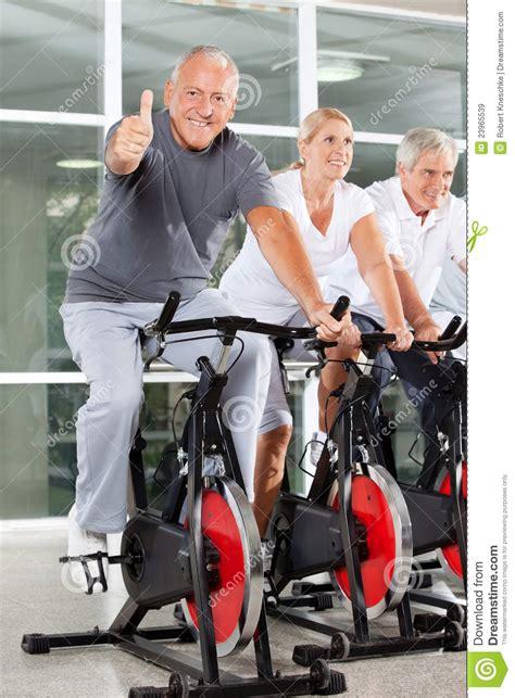Spinning Bike Sport Id 9 2n senior on spinning bike holding royalty free stock