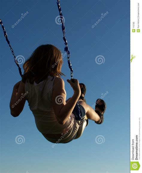 girl in swing girl on a swing stock image image of active motion park