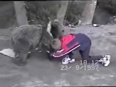 Russian kid man wrestles bear