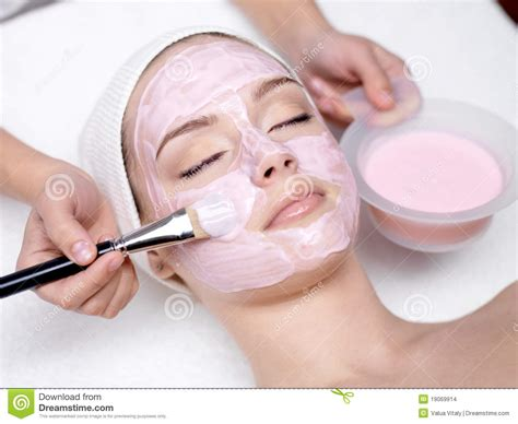 receiving cosmetic pink mask stock photo