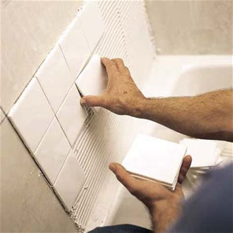 installing tile around a bathtub start tiling how to tile around a tub this old house