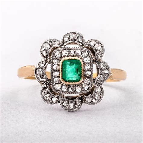 antique emerald and cluster ring