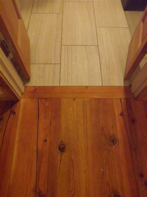 tile  wood floor transition transition  bedroom