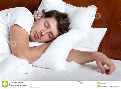 man sleeping in bed man sleeping stock images image 36992454