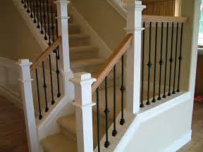 staircase with light wood and white railing and