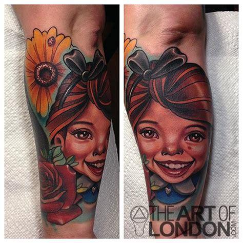 Cartoon Tattoo Artist London   cartoon girl and daisy tattoo by london reese tattoonow