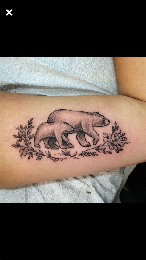 mama bear tattoo and baby in the eye of the beholder the