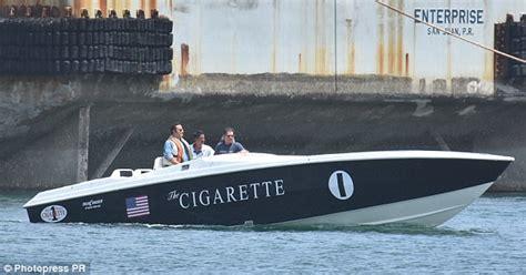 cigarette boat movie john travolta flashes big smile on set of cigarette