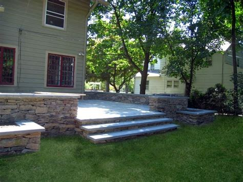 raised patio with walls house ideas