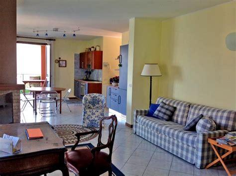 lake como apartment living room in blue argegno lake como view apartment with garden italy magazine