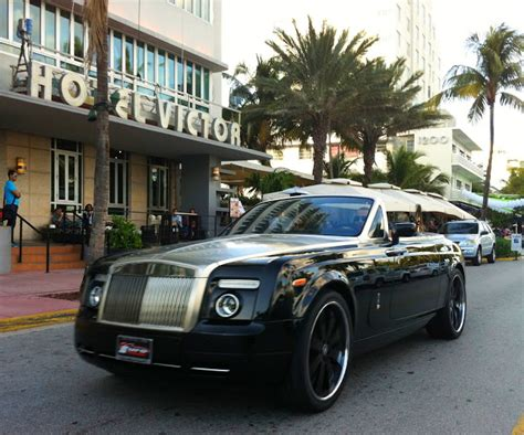 black rolls royce drophead coupe with black rims