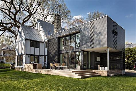 tudor home with a modern twist on lake washington a new york tudor with a modern twist charcoal color