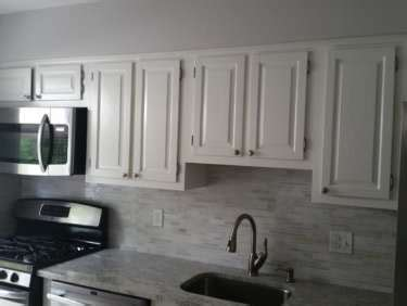 cabinet refinishing vs refacing refacing vs refinishing your kitchen cabinets spectrum