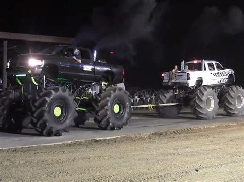 mega truck massive dodge and chevy mega trucks compete in tug a truck