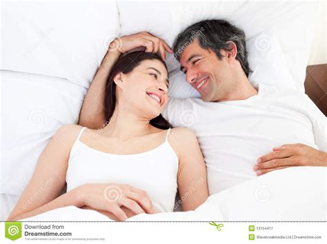 lovely couple in bed lying in bedroom couples hugging on bed auto design tech