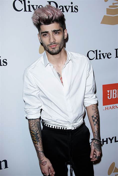 zayn malik debuts new tattoo on his face