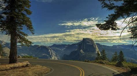 wallpaper  road turn sky mountains