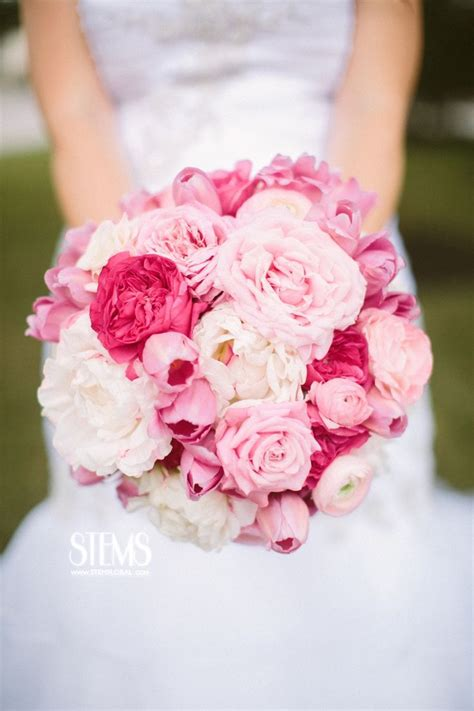 light pink and white the bride will carry a round clutch bouquet of white