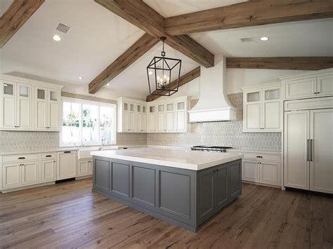ivory cabinets grey kitchen island rustic wood ceiling