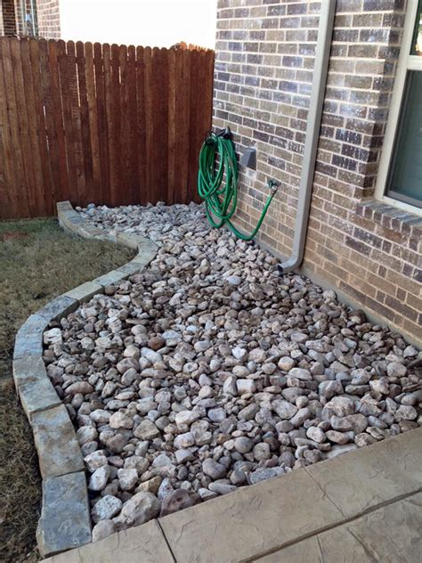 river rock beds remodeling contractor complete