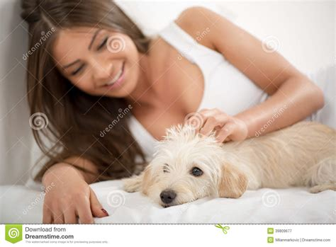 cute girl dog beds cute girl and dog in the morning stock photo image 39809677