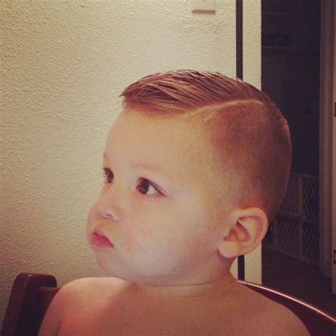 little boy comb over hairstyle high fade pomp over hard part toddler boy