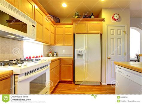 Kitchen With Yellow Wood Cabinets Stock Photo   Image