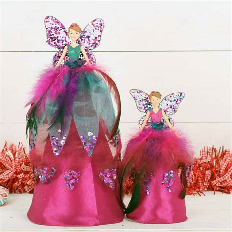 pink tree topper pink peacock tree topper by berry
