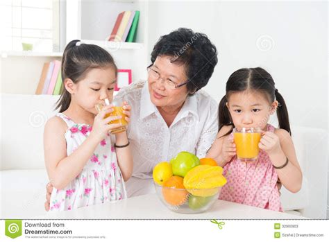 asian children orange juice stock photos image