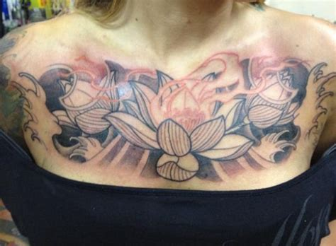 chest lotus rites of passage tattoo