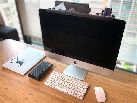 Mac Desk Accessories by Desk Clutter Finds New Home With This Imac Caddy Cult Of Mac