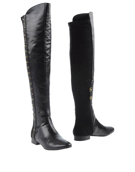 guess boots in black lyst