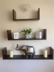 corner white wooden floating shelves on painted wall