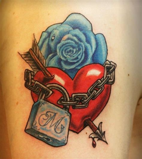 heart with roses tattoo blue with and padlock