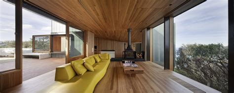 wooden interior geometric beach house with zinc exterior wood interior