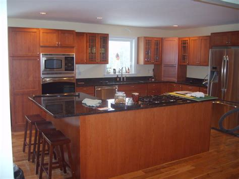 black cherry cabinets with granite countertops