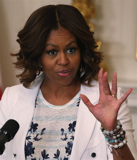 ms obamas new hair do michelle obama medium wavy cut haute hairstyles for