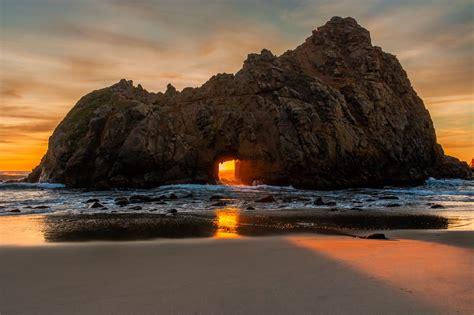nature landscape sunset beach sea rock sand clouds