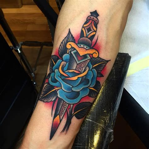 tattoo girl faze traditional dagger rose tattoo on forearm by samuele