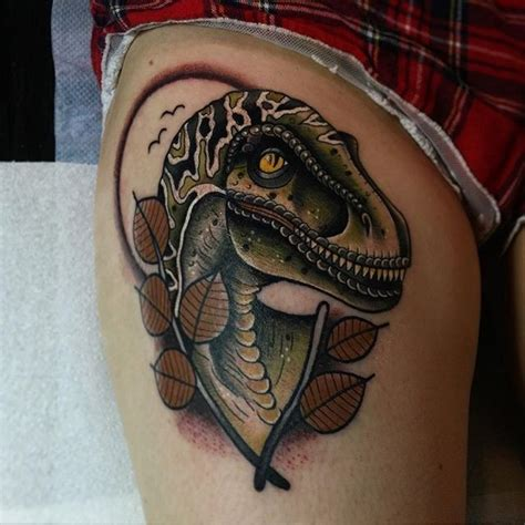 new school dinosaur tattoo new school style colored thigh of dinosaur with