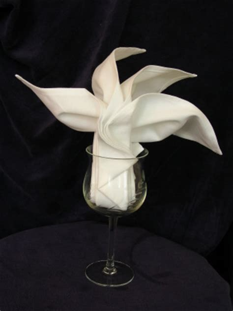 Folding Paper Napkins In Glasses - serviette napkin folding sydney opera fan in wine glass