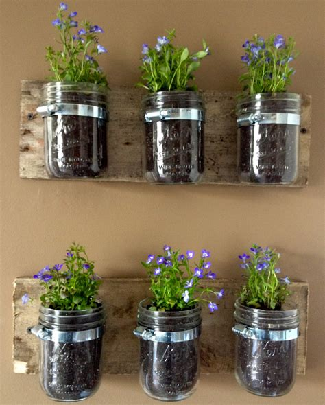 Planters Jar by Diy Hanging Wall Planters From Jars Kasey Trenum