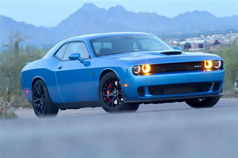 In Hellcat review the dodge hellcat outmuscles the mustang and