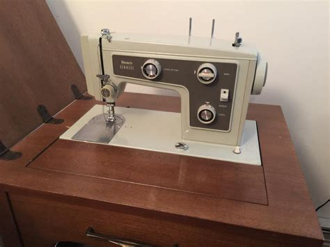sears kenmore sewing machine in solid wood cabinet east