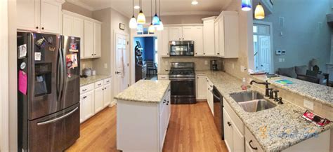 Kitchen Cabinets and Island Painted White Duck White in