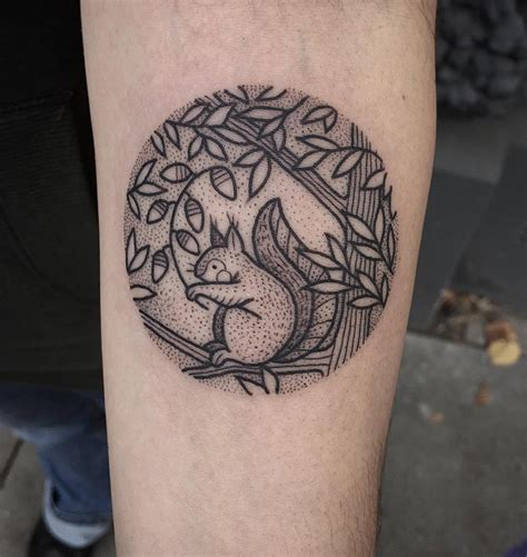 cute squirrel tattoo idea