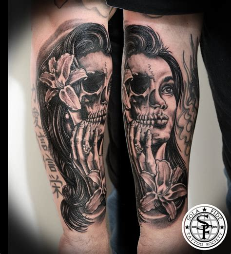 half woman half skull black and gray forearm tattoo