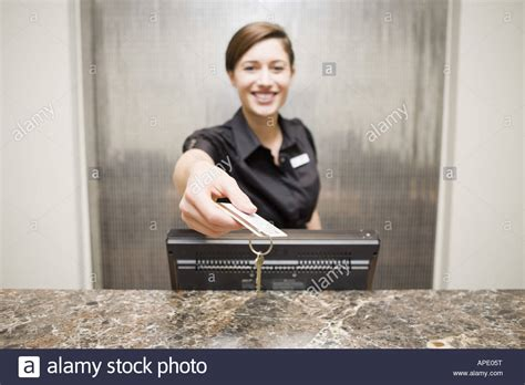 hotel front desk clerk hotel front desk clerk handing keycard stock photo