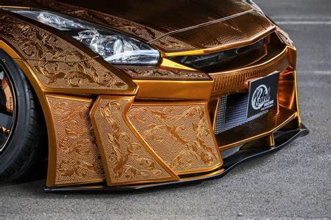 Diesel Godzila Gold this gold plated finely engraved nissan gt r by kuhl